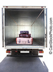open container of the truck with suitcases