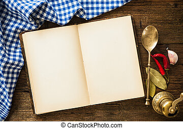 Open cookbook with kitchenware