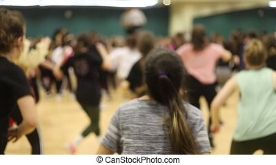 Open dance lesson. A group of people dancing. A girl with...