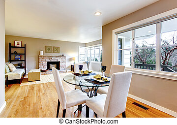 Open design for living and dining room interior. View of the served dining table and living room