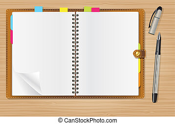 open diary and a pen on office table
