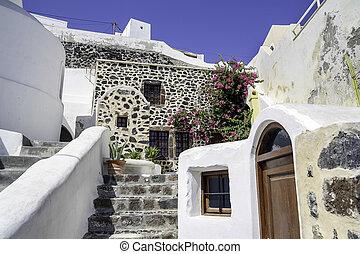 Open door in a typical Greek house of Santorini Island