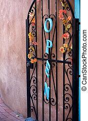 Open door - Metal door to the restaurant in Old Town...