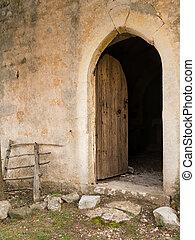 Open door of an old chapel in Croatia