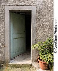 Open door of an old house in Croatia