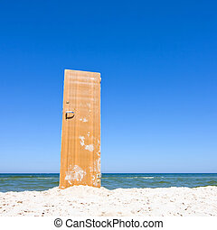 open door to beach and blue sea