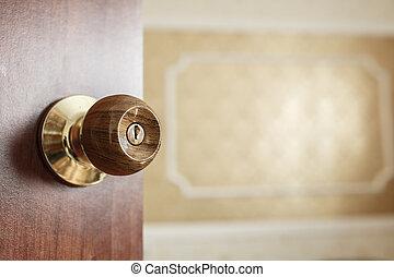 open door to the room, a door handle close up