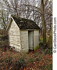 Open Door to the White Outhouse