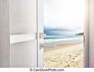 open door with access to the beach. the concept of leisure,...