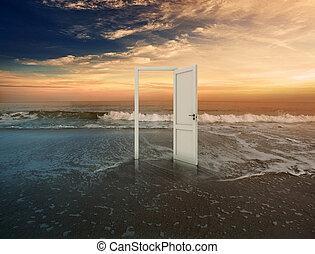 Open doorway on beautiful beach with sunset
