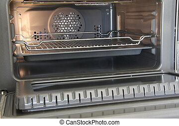 Empty open oven with grill in the kitchen