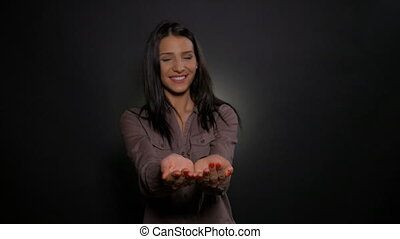 Open empty palms of woman shown to camera like offering...