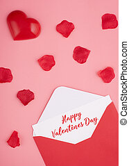 open envelope with card, heart and rose petals on pink background with the inscription Happy Valentines Day