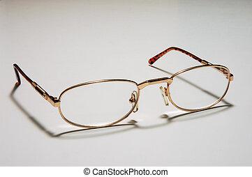 open eyeglasses on white background