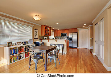 Open floor plan. Dining and kitchen room interior.