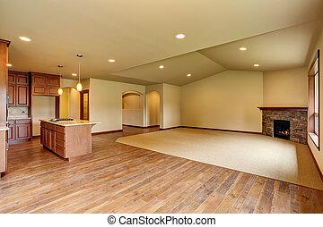 Open floor plan. Empty living room with carpet floor.