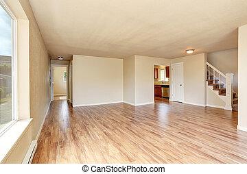 Open floor plan. Empty room interior with hardwood floor.