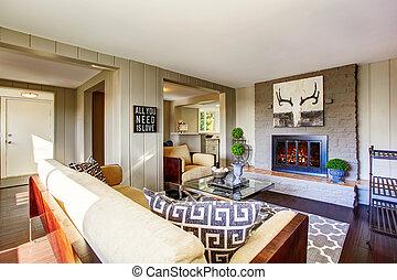 Open floor plan living room with fireplace, comfortable sofa