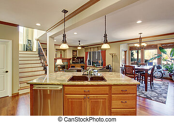 Open floor plan. View of kitchen island with sink