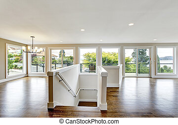 Open floor plan. View of stairs to first floor.