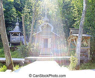 Open font in the sun. Holy Spring St. Sergius of Radonezh. Waterfall Gremyachiy key.