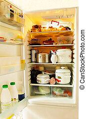 opened refrigerator inside full of various foodstuff