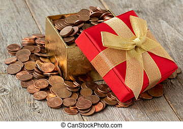 Open gift box full of coins