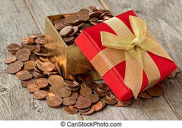 Open gift box full of coins
