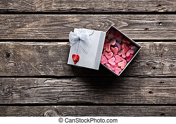 Open gift box with hearts