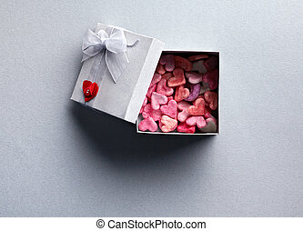 Open gift box with lots of cute little hearts