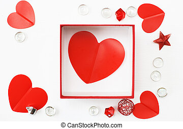 Open gift box with red hearts on a white background. greeting card