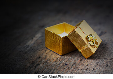 Open gift on a wooden surface