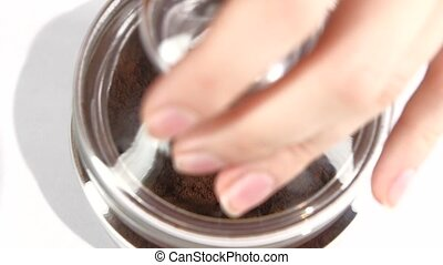 Open glass jar of instant coffee, using spoon, slow motion,...