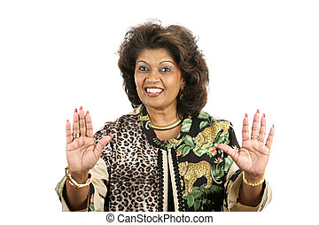 Open Handed - A pretty ethnic woman with her hands up, palms...