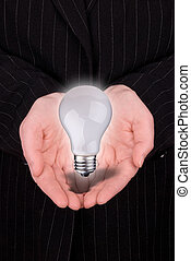 hands of a business woman with lightbulb