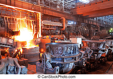Pouring of liquid metal in open-hearth workshop of metallurgical plant