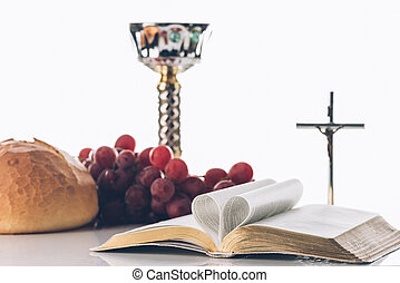 open holy bible with christian cross, and chalice on table, Holy Communion
