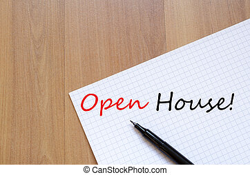 Open House Concept - White blank notepad on office wooden...