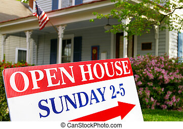 Open House sign if front of house for sale