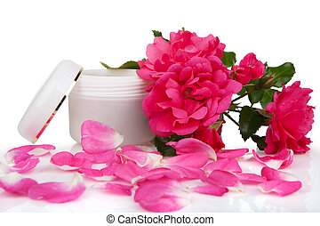 Open jar with the cosmetic cream and rose petals isolated on...