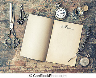 Open journal book and vintage writing tools. Memories. Retro sty