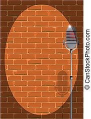 A microphone ready on stage against a brick wall.