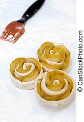 Open mini pies prepared for baking
