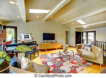 Open modern luxury home interior living room with piano.