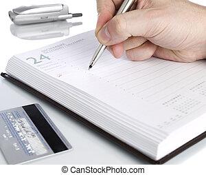 Open notebook - A notebook open on december twenty fourth, a...
