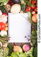 open notebook and fresh vegetables