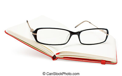 Open notebook and glasses isolated on white