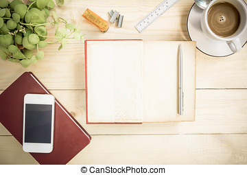 Open notebook diary on wooden table with coffee, Vintage Style.