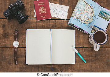 open notebook on a table to plan a trip - open notebook on a...