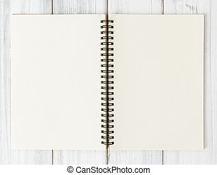 Open notebook on white wood table background, flat lay
